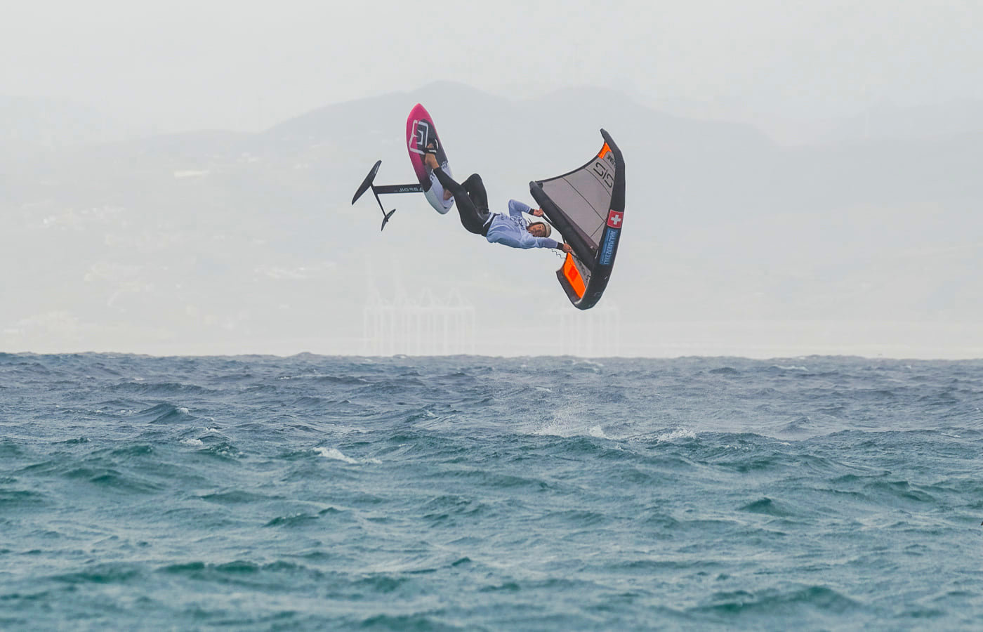 Balz Muller jumping on a wing foil session